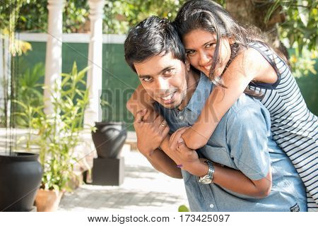 happy south asian couple enjoying together outdoors