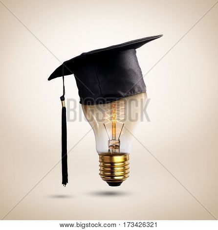 congratulations graduates cap on a lamp bulb concept of education.