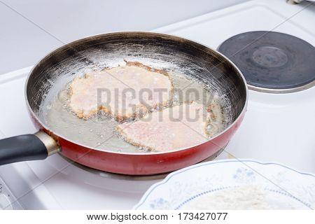 Frying Pork Meat In The Frying Pan