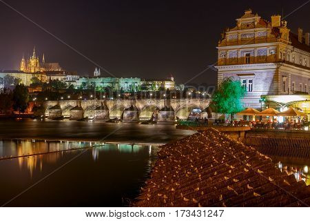 Charles Bridge in the night light. One of the oldest bridges in Europe. Prague. Czech Republic.
