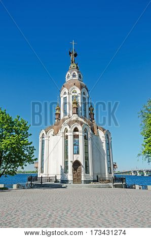 Orthodox temple on the waterfront against the blue sky in end of April
