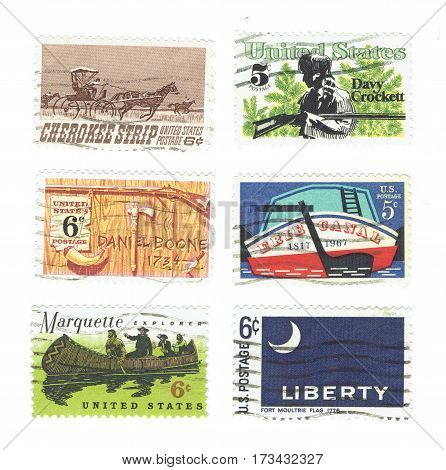 USA - CIRCA 1967 - 1968: Arrange of used postage stamps printed in USA shows Stern of Erie Canal, Cherokee Strip of Kansas, Davy Crockett and Daniel Boone, Marquette explorer and the Fort Moultrie Flag, circa 1967 and 1968