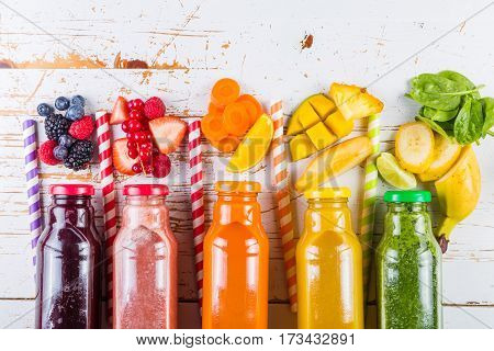 Selection of colourful smoothies on rustic wood background, copy space