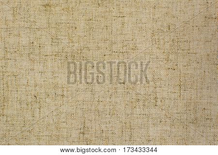 Light natural linen fabric for the background. Texture of natural raw material