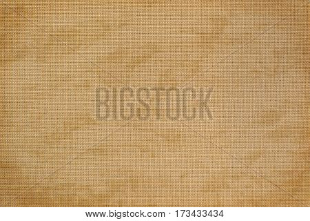 Vintage natural linen fabric with free designs for the background. Texture of natural raw material