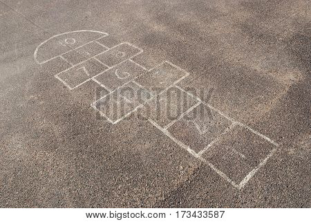 Childrens hopscotch at playground in school, background