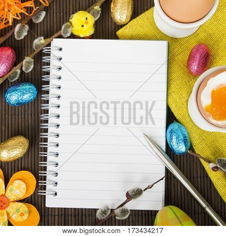 Blank notebook and Easter decorations, copy space