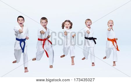Five karateka children are beating punch arm