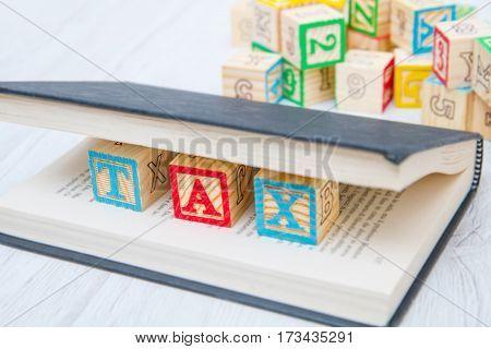 Tax Written On Wooden Cubes