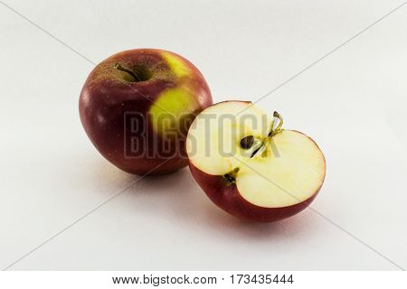 One and a half apple isolated on white background