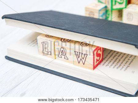 Law Written On A Wooden Cubes