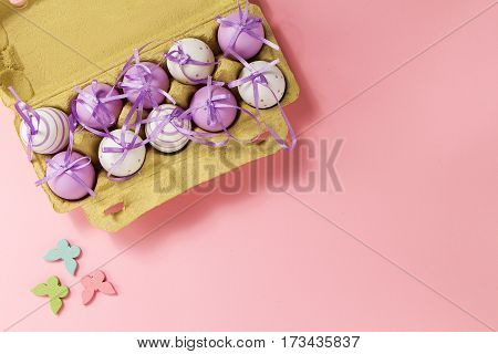 Easter or Spring Food Concept. Fresh Eggs in Box for Eggs on Pink Pastel Background. Top View.