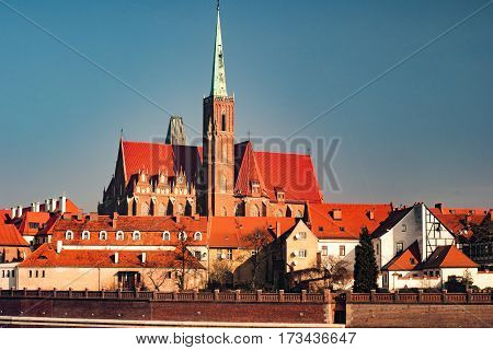 View on Church of the Holy Cross and St. Bartholomew, Odra river and Tumski Island, Wroclaw, Poland. Beautiful winter landscape.