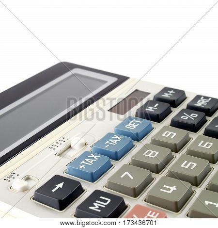closeup blue tax button on white calculator, selective focus, tax calculation concept