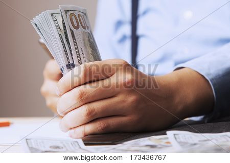 Very happy businessman with money in hand. (Success freedom financial prospects career advancement)
