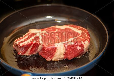 Raw Beef Loin On The Bone (marble), Fried In A Skillet.