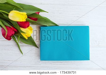A bouquet of spring flowers tulips. Top view. Concept of holiday birthday Easter March 8.