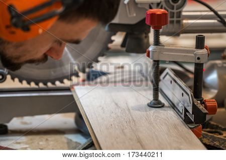 A Man Working With Electric Saw
