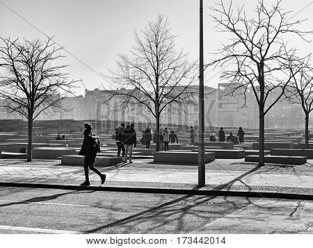 BERLIN GERMANY - FEBRUARY 14 2017: Tourists At The Memorial to the Murdered Jews of Europe Berlin black and white