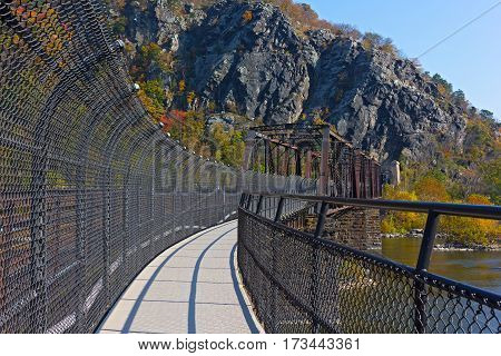 Appalachian trail over the river in West Virginia USA. Footpath over Shenandoah River in historic Harper Ferry town.