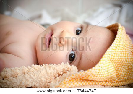 newborn hood eyes closeup gaze face portrait