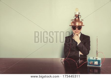 Businessman sitting at office desk with vintage goggles