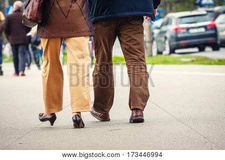 Man and woman walk along the streets back view.