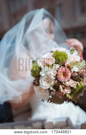 wedding bouquet of gorgeous white roses at bride's hand.