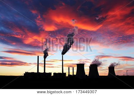 dramatic red sunset over brown coal power station