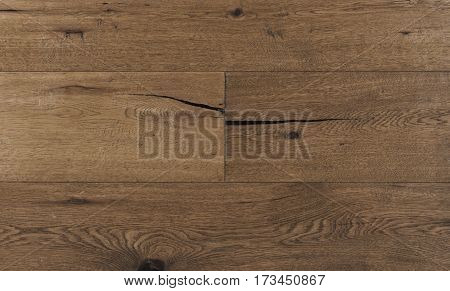 Top view photo of vintage rustic smoked Australian oak wood floor boards with rough texture brushed and handscraped