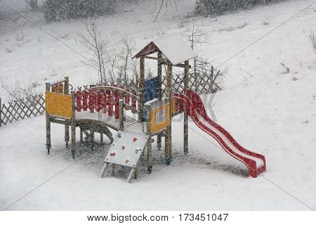 Playground for children, buried in snow winter season
