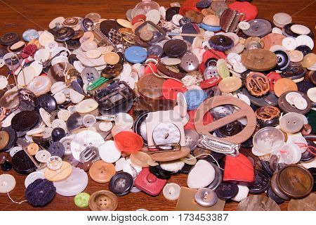 Assorted Buttons. Different In Color, Mostly Plastic, Some Wooden. Pile Of Buttons Close Up Backgrou