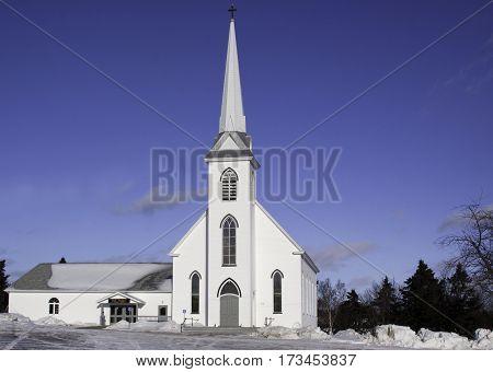 Miramichi, Catham, New Brunswick, February 6, 2017 -- Horizontal winter snow scene Saint Samuels parish in Miramichi, New Brunswick, on cold but bright sunny blue sky day in February.