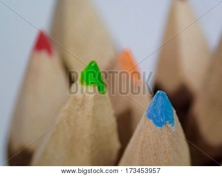 Vibrant colored pencil tips appear like mountain  peaks.
