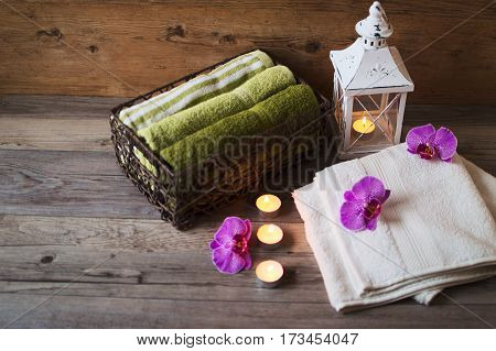 Relax in the spa centre. Natural aroma oil and cotton towels. Easy and soothing atmosphere of relax. Candles are glow.