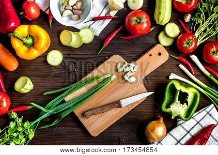 ingredients for vegetable ragout on wooden background top view.