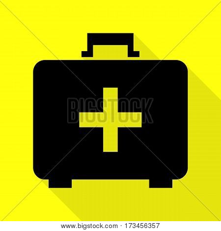 Medical First aid box sign. Black icon with flat style shadow path on yellow background.