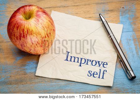 improve self motivational reminder - handwriting on a napkin with a fresh apple
