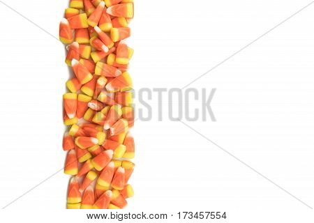 Candy Corns in Vertical Row on Isolated White Background