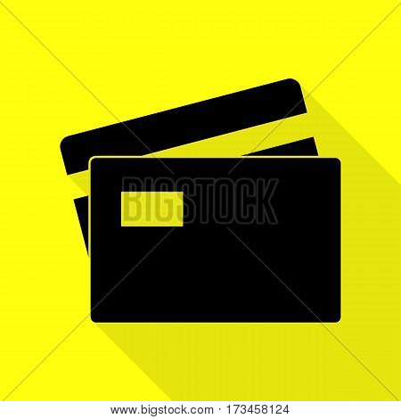 Credit Card sign. Black icon with flat style shadow path on yellow background.