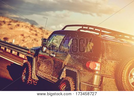 Dirty Off Road Trip. Dirty Full of Mud SUV Type Car Right After Crossing Wet Desert.