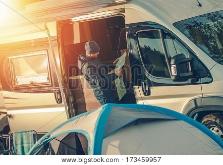 Men Camping in His Motorhome and Planning New Exciting Scenic Road Trip.