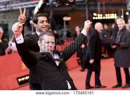 Janne Hyytiainen, Simon Hussein Al-Bazoon arrive for the closing ceremony of the 67th Film Festival Berlin at Berlinale Palace on February 18, 2017 in Berlin, Germany.