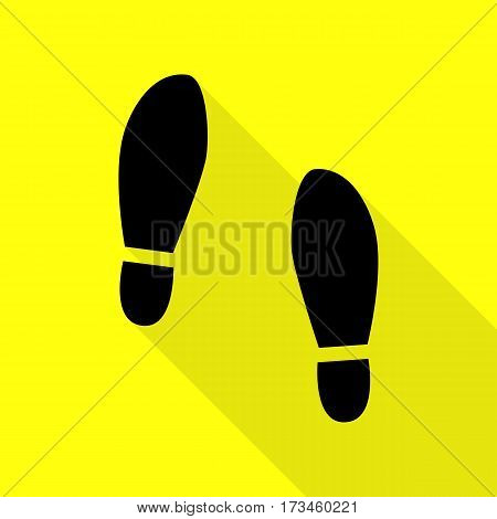Imprint soles shoes sign. Black icon with flat style shadow path on yellow background.