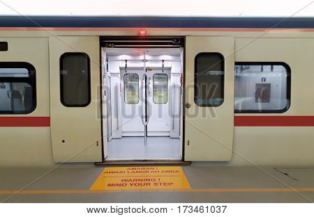 Train at station platform with open door