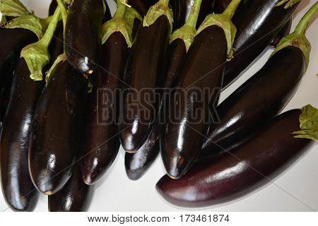 Fresh eggplants on white background, fresh vegetables, healthy food