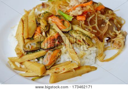 stir fried bamboo shoot with mussel and glass noodle on rice