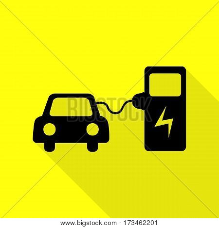 Electric car battery charging sign. Black icon with flat style shadow path on yellow background.