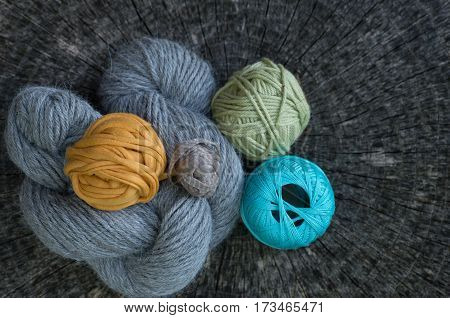 Close Up Of Knitting Yarns On Tree Ring Background