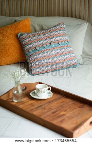 Blooms And Cup Of Tea In Wooden Tray In Bed